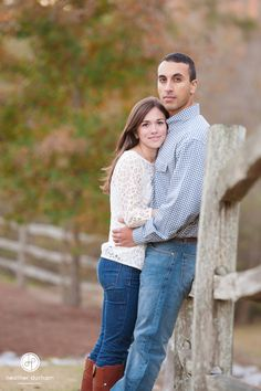 Fall engagement session. Couple leaning on split rail fence surrounded by fall color. Birmingham, Alabama engagement and wedding photographer.  http://www.heatherdurhamphotography.com