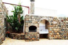 barbecue en pierre naturelle de style oriental avec un vier extrieur et pole