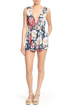 In love with this floral romper with a plunging neckline and leg-flaunting shorts.