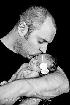 Newborn photography baby and dad
