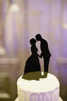 Cake topper from Simply Silhouettes - looking up at fireworks with sparklers between.