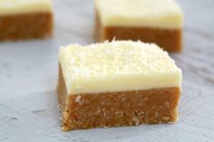 This new and improved Lemon Coconut Slice recipe is absolutely perfect! Beautiful tangy base topped with a creamy lemon frosting - Thermomix and conventional methods included.