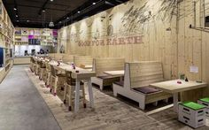 Ippolito Fleitz Group designers have designed interior space of WakuWaku fast food restaurant and organic food store in Hamburg, with a little help of artist Chris Rehberger. Restaurant Booth, Restaurant Seating, Fast Food Restaurant, Organic Restaurant, Booth Seating, Store Interiors, Restaurant Interior Design, Restaurant Interiors, Cafe Design