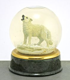 "This white wolf snow globe was a ""limited edition"" made for World Wildlife Fund. It has a beautiful green marble base. Unlike the t-shirts sold on Amazon, this wolf is utterly non-ironic. And he probably would be miffed by any snark about being a lone wolf."
