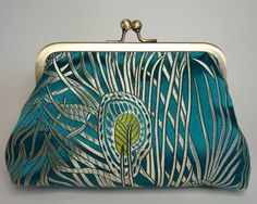 Turquoise and bronze peacock feather clutch by MercurioMillinery, £20.00
