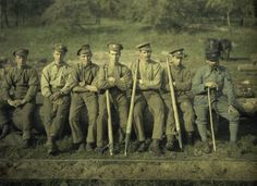 Quesmy, a group of Canadian forestry workers (sitting on a trunk of tree. Trade of Noyon. Oise. France. 1917).