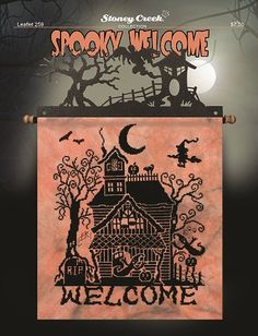 """Stoney Creek - Leaflet 259 Spooky Welcome. Stitch count 150w x 183h, approximately 10 3/4"""" x 13"""" on 14ct. Model stitched on 28ct Hand Dyed """"Eek!"""" Cashel Linen from Picture This Plus using black embroidery floss (we used 11 skeins). The design is embellished with two hand made bat buttons and displayed on a 12"""" Haunted House fabric holder. A fat quarter cut of fabric will be more than enough for this project. We think this design will also look great on """"Tropical Orange"""" Aida or Linen."""