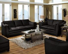 Trying to figure out how to make black leather couches feel less bachelor pad