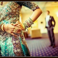 Creative way to show off your bangles... Pakistani wedding photos are notoriously stiff otherwise