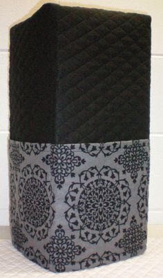 Check out this item in my Etsy shop https://www.etsy.com/listing/188645965/black-gray-quilted-damask-medallion