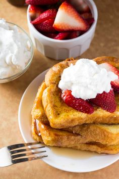 The BEST French Toast - fluffy, buttery, golden brown, topped with maple syrup and the perfect reason to get out of bed! So easy & so delicious