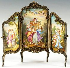 Miniature tri-fold Screen with ornate cast rococo style silver frame and Viennese enamel panels, ca. 1890, via liveauctioneers.