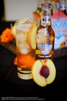 Twist, pour and serve this peachy-keen Smirnoff Ice Peach Bellini at your fall party. #SmirnoffIce #fall #party
