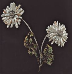 Henri Vever. Corsage Brooch. Petals of the two chrysantemum flowers are formed of elongated dog-tooth pearls produced by Mississipi River mussels. World's Fair Paris 1900.