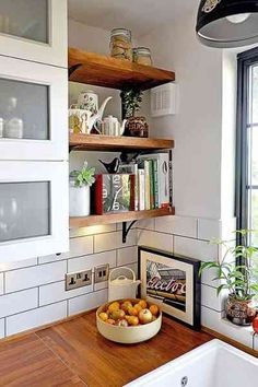 Shelves, Black kitchen countertops and White subway tile backsplash