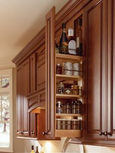 See all your spices with this Spice Pull-Out cabinet by Thomasville Cabinetry. #harpersbazaar #mydreamkitchen