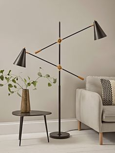 With the most fabulous contemporary design, our statement floor lamp will make a striking feature in any room of your home. Each lamp features two arms, each with an adjustable, conical shade to the end, with a matte black finish and brass details. Copper Floor Lamp, Industrial Floor Lamps, Black Floor Lamp, Led Floor Lamp, Metal Floor, Brass Lamp, Retro Floor Lamps, Modern Floor Lamps, Farmhouse Floor Lamps