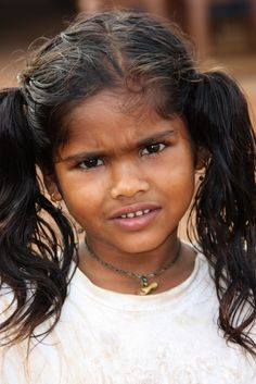 https://flic.kr/p/7G42Vx | Small girl with shaggy hair - Terre d'Espoir 1 | These are the children of Goa's migrant workers. Janine Gaiddon from France comes to Colva in South Goa for five months every year to help the children. She gives over a hundred a day breakfast, provides basic first aid and helps those who go to school remain by donating uniforms, stationery and giving them lunch. She is a truly amazing lady. She is funded by a small charity, Terre d'Espoir, which she and her late…
