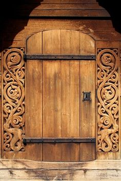 Beautiful wood carved side door at Heddal stave church in Notodden, Norway