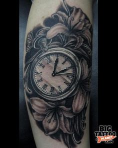 I like the integration of the pocket watch and flowers on this tattoo