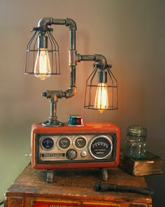 18 Gorgeous Steampunk Machine Age Lamps Maybe I could make something like this out of things from garage sales . PVC pipes maybe