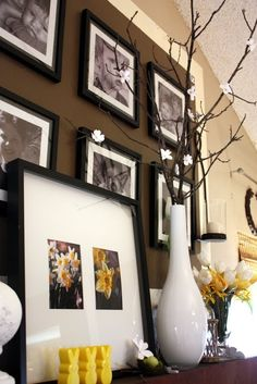 brown accent wall & black picture frames....  love everything about this!  click for tutorial on making dogwood branches, and to see more details about her arrangement