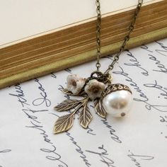 Acorn Necklace (looks like a book mark doodad, but meh I'd wear it as a long dangling necklace...)