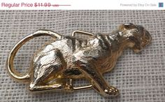 #etsy #ecochicteam #gotvintage #sale #vintage ❘❘❙❙❚❚ ON SALE ❚❚❙❙❘❘     Shiny gold tone African jungle predator buckle for women. Note that there are other items in my shop that will go nicely