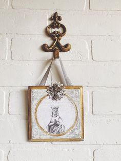 vintage mother mary wall plaque a charming shabby piece i've added a beautiful image of mother mary in shades of white and grey to a charming vintage wall plaque adorned with a filigree round and cross with a wee rhinestone painted in shades of silver and gold has a hook on the back for hanging but