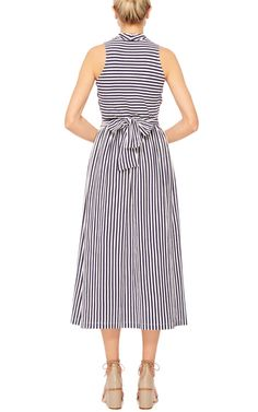 Former interior designer Mark D Sikes celebrates classic stripes and American sportswear with a fresh, sophisticated approach. This sleeveless **MDS Stripes** dress is rendered in cotton and features a crossover v-neckline with a slight a-line silhouette, a midi length skirt, and a sash at the waist.