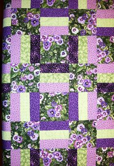 This quilt was made using just 4 fabrics and very simple piecing. They did a great job coordinating fabrics. Love the colors.