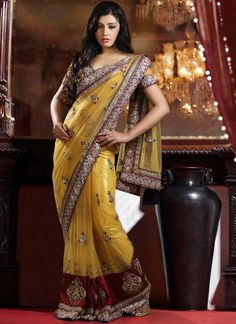 Spectacular Yellow Net Embroidered Saree