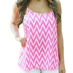 "Pink Chevron racer back tank Adorable spring and summer item. Tag says a medium and it is flowy but please check measurements to ensure a good fit. I believe this fit is more a small... Measures 26"" from shoulder strap to hem and laying flat measures 17"" across the bust. boutique  Tops Tank Tops"