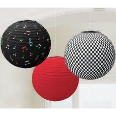 """Add some fun to your 50's party with these 3 piece paper lantern pack that also includes the string to hang the 9.5"""" lanterns. Includes 1 red, 1 black and white checkered, and 1 black with multicolore"""