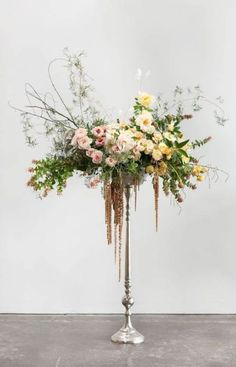 Best Tall wedding centerpieces - weddingtopia Turn the vase until you're pleased with how the floral arrangement looks with the pedestal and the remainder of the room Vintage Wedding Centerpieces, Floral Centerpieces, Wedding Decorations, Centerpiece Ideas, Tall Floral Arrangements, Wedding Flower Arrangements, Floral Wedding, Wedding Flowers, Diy Wedding