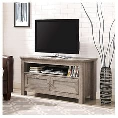 Wood TV Stand in Driftwood - Walker Edison a beautiful centerpiece for your home entertainment with this wood TV console. Crafted from high-grade MDF with a durable laminate finish supports TVs up to Features open and con Wood Storage, Storage Spaces, Media Storage, Tv Media Stands, Tv Stands, Tv Stand With Storage, Tv Stand With Doors, Driftwood Furniture, Television Stands