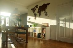 Our Sunsoaking living room with Palisander Wooden Map-a-Wall. Modern art for travel addicts!