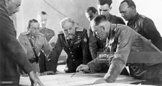 Rommel, Erwin *1891-1944+ Officer, general field marshall, germany commander of the german africa corps Feb.41-March 43 (WWII) - Rommel (Lt.Gen.) together with Italo Garibolde (Gouverneor ans supreme commander in Libya) studying the map in a discussion of the situation. - about