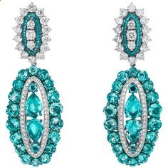 "Chopard Earrings from the ""Temptations Collection"" featuring 10.66-carats of green beryls, 3.39-carats of diamonds and .10-carats of emeralds set in 18kt white gold."
