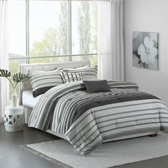 The Madison Park Pure Neruda Collection creates an organic look for your modern space. This interesting seersucker stripe adds dimension and simplicity with textured grey and off white stripes. Printed on 200 thread count cotton, this set includes a comforter, two shams and two decorative pillows.