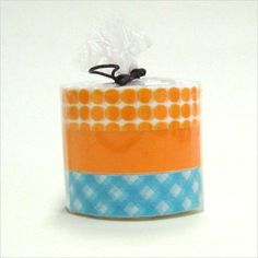 A fun set of candy color Japanese Masking Tape. This one has a orange circle dot, orange solid, and a orange criss cross.  $8.25