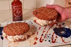 This Sriracha ice cream sandwich is a spicy cool treat. The ice cream, which is Thai Basil Vanilla Bean, is sandwiched between a Sriracha, peanut butter and chocolate chip cookie with shredded toasated coconut. For another rooster hot sauce hyrbid, c Peanut Butter Ice Cream, Vanilla Bean Ice Cream, Peanut Butter Cookies, Frozen Desserts, Just Desserts, Basil Ice Cream, Sriracha Sauce, Sriracha Recipes, Tasty