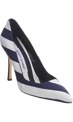 0fb05397229 The Manolo Blahnik Pamufac Pumps reinvents a classic design and  incorporates modern appeal to it. These pointed toe pumps have grosgrain  leather upper which ...