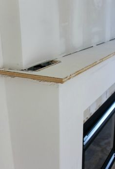 Fireplace Makeover Progress - details of our white and marble fireplace update - Satori Design for Living