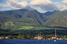 Photo taken of Lahaina and the West Maui mountains back in the day when sugar cane grew on the slopes.  The Pioneer Inn is the white building w/red roof, and the schooner Carthiginian is docked at the Lahaina Harbor!  The Carthiginian was subsequently scuttled off of Puamana and is now enjoyed as a dive site in approximately 110 ft. of water.