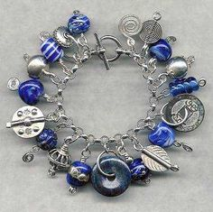 Click Here for a larger picture, ordering and price information, and to see more of our exotic treasure sterling silver charm bracelets!