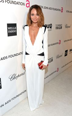 Looking sexy yet sophisticated, the TV personality dons a black-and-white plunging neckline gown by Roberto Cavalli.