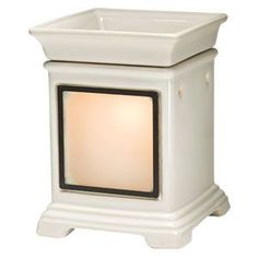 Classic Cream Gallery Warmer. Choose any frame to be illuminated as it melts your favorite scent.  http://www.lovingsomescents.com
