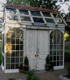 Recycled doors and windows make for a beautiful greenhouse.