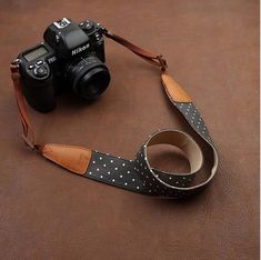 Cowboy Flower Nikon Cannon Sony Handmade Leather Camera Strap Brown 7115 Handmade with top layer cow leather and denim. It can fit almost every DSLR, SLR and some larger digital cameras.